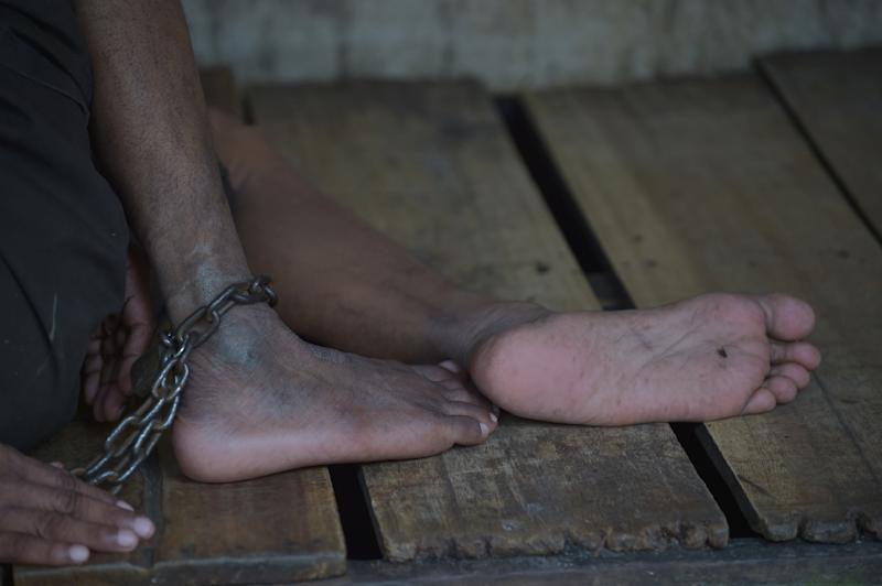 A mentally ill Indonesian man is shackled at the Bina Lestari Mandiri healing center in Brebes (AFP Photo/Adek Berry)