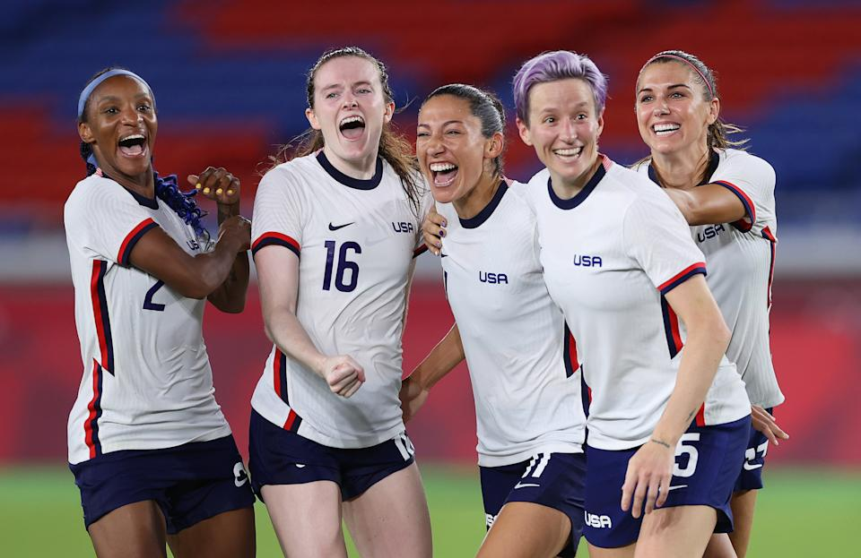 Crystal Dunn #2, Rose Lavelle #16, Christen Press #11, Megan Rapinoe #15 and Alex Morgan #13 of Team United States celebrate following their team's victory over Netherlands on July 30. (Laurence Griffiths/Getty Images)