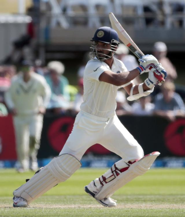 India's Ajinkya Rahane plays a shot against New Zealand during the first innings on day two of the second international test cricket match at the Basin Reserve in Wellington, February 15, 2014. REUTERS/Anthony Phelps (NEW ZEALAND - Tags: SPORT CRICKET)