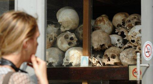 A tourist looks at skulls of Khmer Rouge's victims at the site of the former killing fields in Choeung Ek