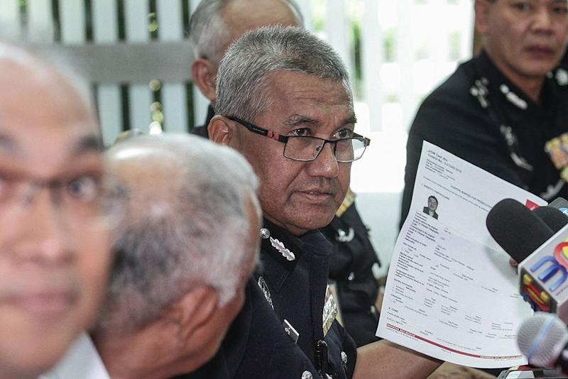 IGP Tan Sri Mohamad Fuzi Harun speaks during a press conference in Subang Jaya July 19, 2018. — Picture by Miera Zulyana
