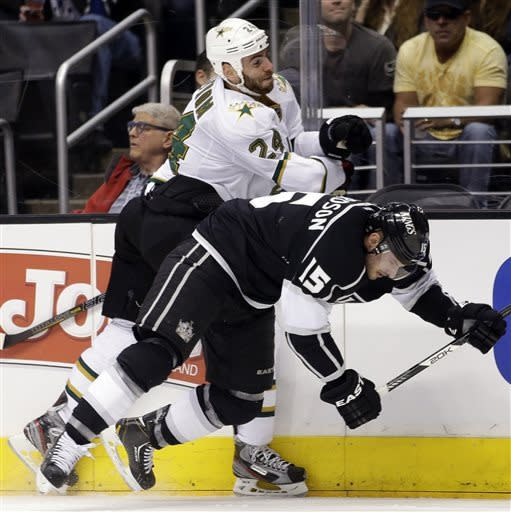 Los Angeles Kings' Brad Richardson (15) is shoved by Dallas Stars' Eric Nystrom during the first period of an NHL hockey game in Los Angeles, Sunday, April 21, 2013. (AP Photo/Jae C. Hong)