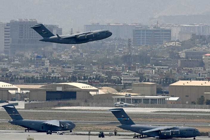 An US Air Force aircraft takes off from the airport in Kabul on August 30, 2021. Rockets were fired at Kabul's airport on August 30 where US troops were racing to complete their withdrawal from Afghanistan and evacuate allies under the threat of Islamic State group attacks.