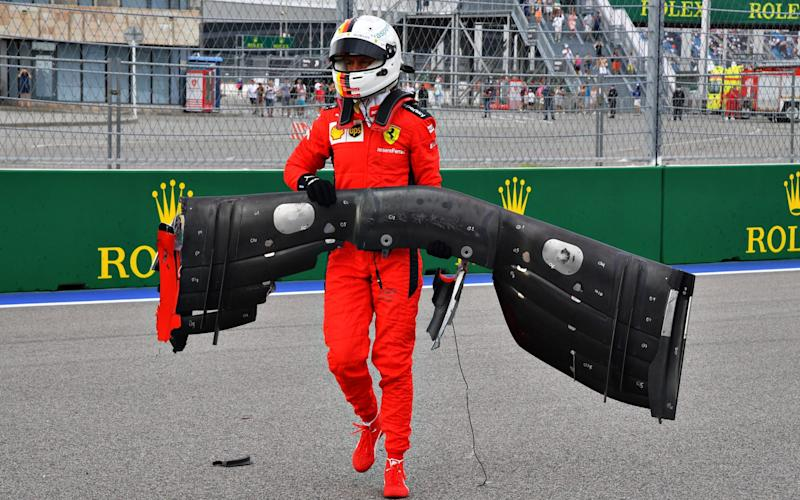 Sebastian Vettel of Germany and Ferrari retrieves his front wing from the track after crashing during qualifying ahead of the F1 Grand Prix of Russia at Sochi Autodrom on September 26, 2020 in Sochi, Russia - Getty Images Europe