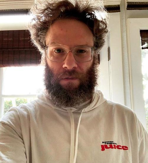 seth rogan with glasses in sweatshirt looking at camera
