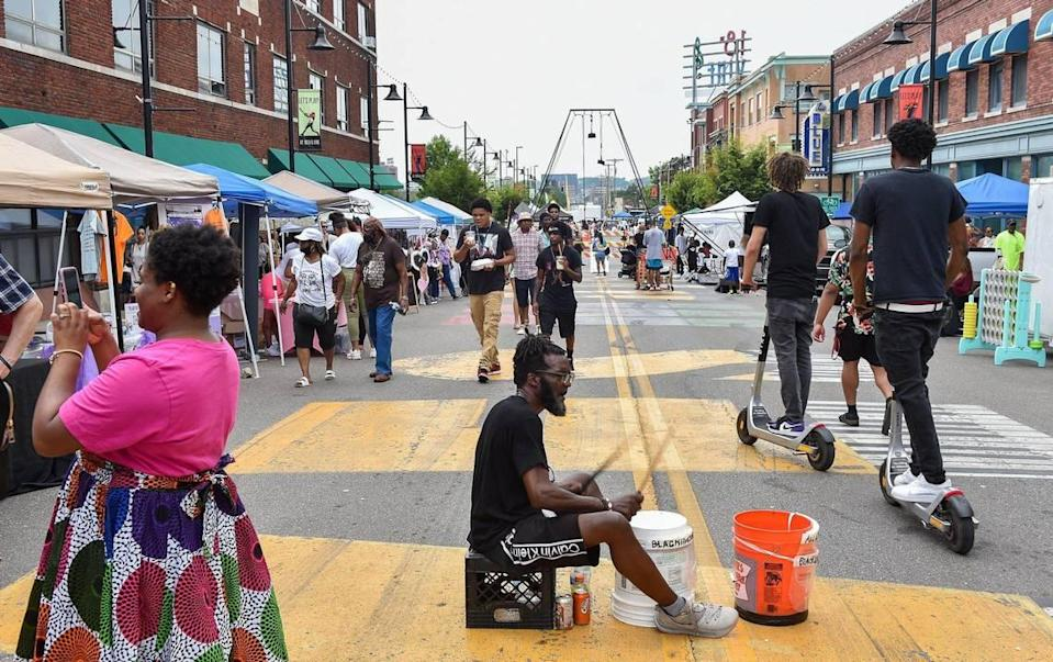 """Ed """"Bucketman"""" Humes plays his buckets on 18th Street during Kansas City's Juneteenth Heritage Festival in the 18th and Vine Jazz District Saturday, June 19, 2021."""