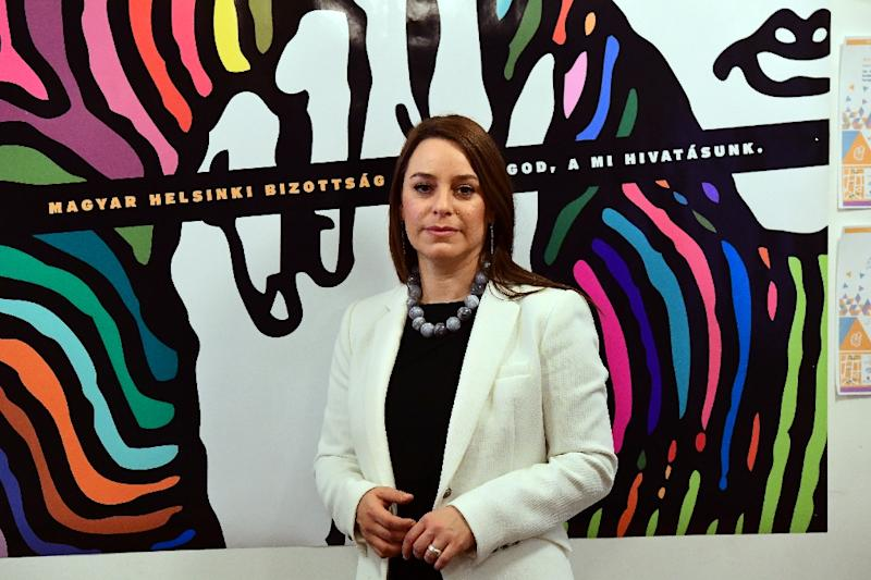 Co-Chair of the Hungarian Helsinki Committee, Marta Pardavi, poses for a photo in Budapest (AFP Photo/ATTILA KISBENEDEK)