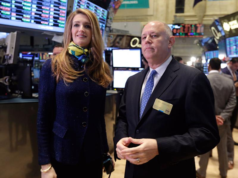Intercontinentalexchange Chairman and CEO Jeffrey Sprecher, and ICE Vice President of Corporate Affairs Kelly Loeffler visit the floor of the New York Stock Exchange Monday, Nov. 18, 2013. (AP Photo/Richard Drew)