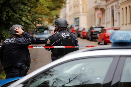 Police officers are seen at the site of a shooting in Halle