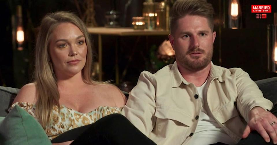 Married At First Sight's Bryce and Melissa on the couch