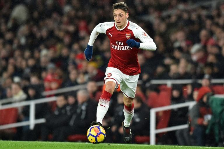 A spectacular first-half goal from Mesut Ozil saw Arsenal beat Newcastle 1-0 and end a three-match winless run