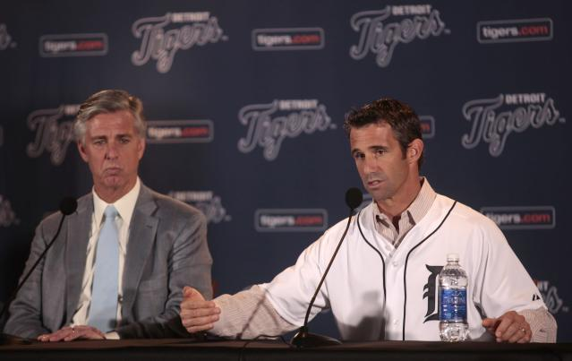 Detroit Tigers General Manager Dave Dombrowski (L) listens as newly named Tigers manager Brad Ausmus answers questions during a press conference announcing Ausmus as the 37th manager in franchise history of the Tigers in Detroit, Michigan November 3, 2013. REUTERS/Rebecca Cook (UNITED STATES - Tags: SPORT BASEBALL)