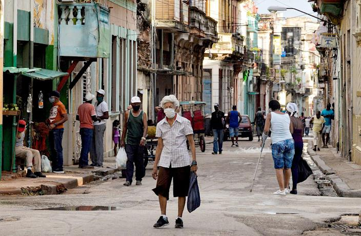 Image:  An elderly person wearing a mask walks along a street of Havana, on April 6, 2021. (Yamil Lage / AFP - Getty Images)