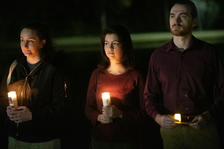 Mourners attend a candlelight vigil organized by the Bush School of Government and Public Service at the George Bush Presidential Library in College Station, Texas