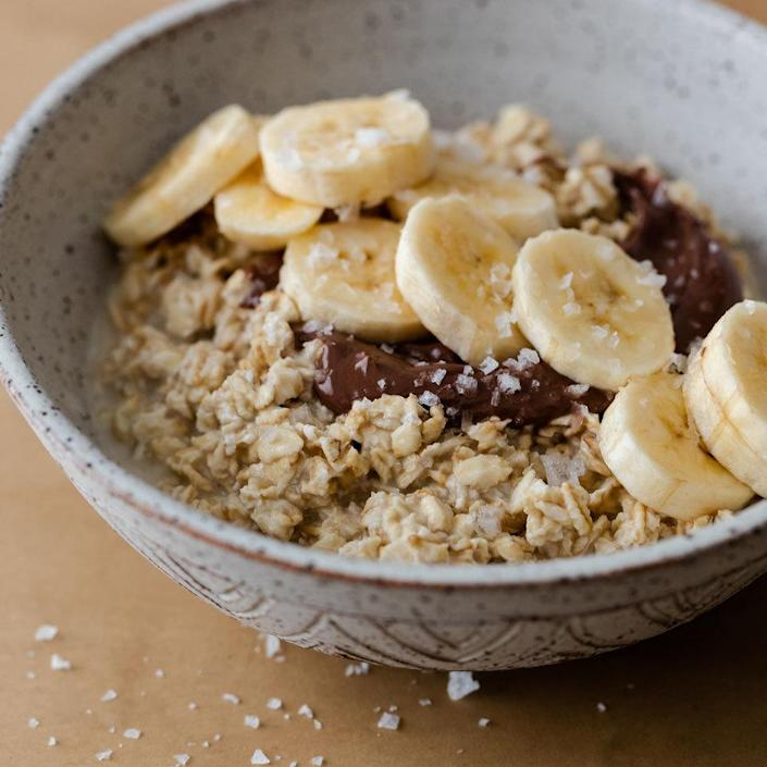 """<p>Chocolate-hazelnut spread adds a touch of luxury to your humble bowl of overnight oatmeal. Banana slices pair perfectly with the spread and add natural sweetness (no need for additional sugar). A sprinkle of flaky salt helps keep this quick breakfast from being cloyingly sweet. <a href=""""https://www.eatingwell.com/recipe/269657/chocolate-banana-overnight-oats/"""" rel=""""nofollow noopener"""" target=""""_blank"""" data-ylk=""""slk:View Recipe"""" class=""""link rapid-noclick-resp"""">View Recipe</a></p>"""