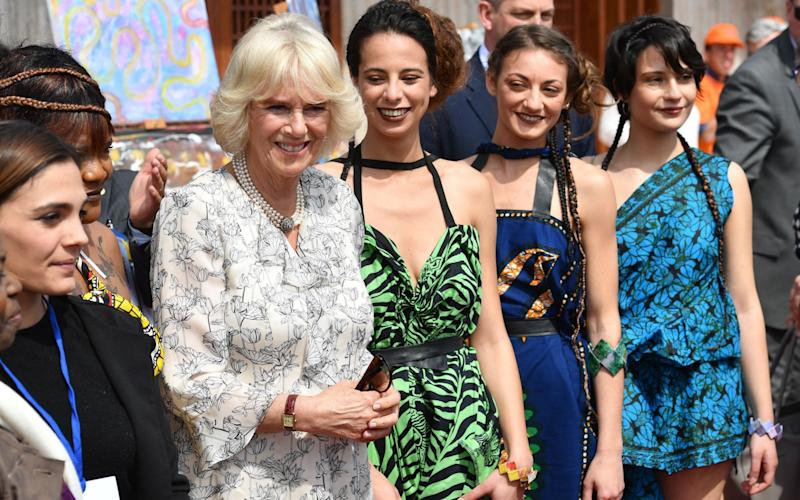 Duchess of Cornwall at fashion show of work designed by former victims of human trafficking - Credit: Rex Features