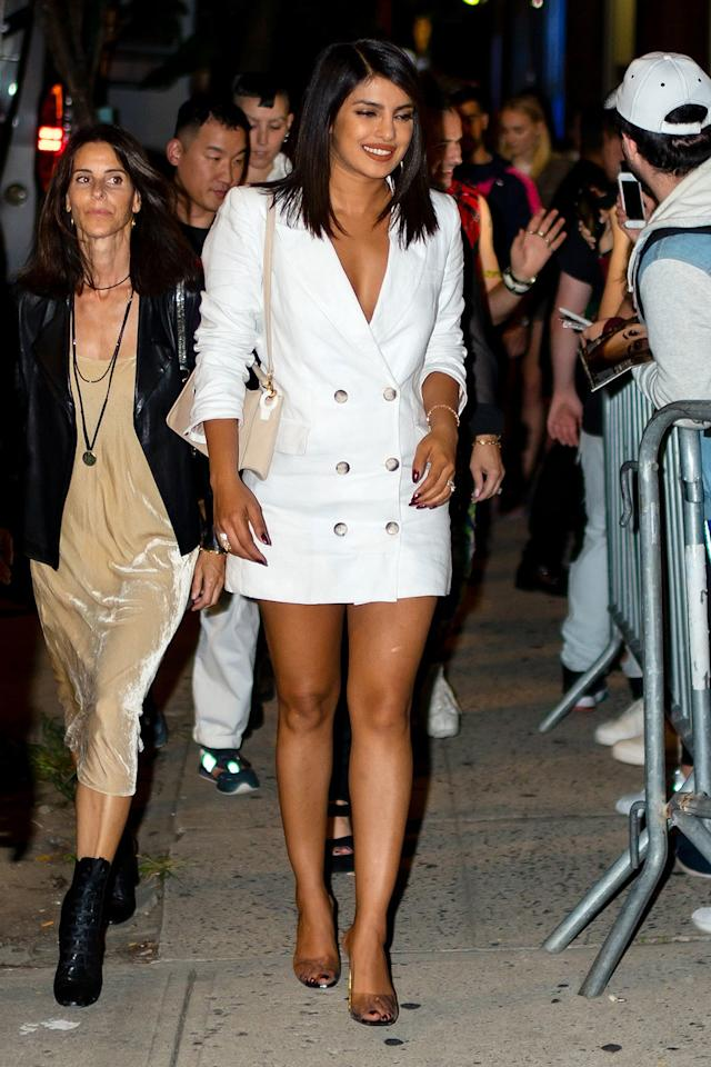 wears a white double-breasted Reformation suit dress at the Nick Jonas x John Varvatos Villa One Tequila launch party in N.Y.C.