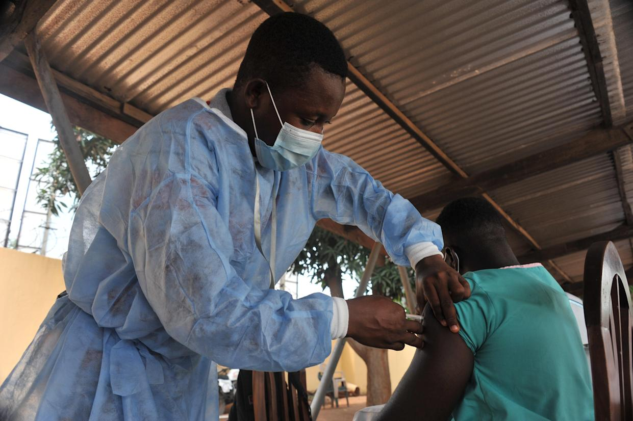 ACCRA, March 2, 2021 -- A nurse administers the COVID-19 vaccine to a man at a hospital in Accra, Ghana, on March 2, 2021. The government of Ghana Tuesday rolled out a program to commence the mass vaccination of people living in some 43 epicenter-districts in the Greater Accra, Ashanti and Central regions against the COVID-19 pandemic. (Photo by Seth/Xinhua via Getty) (Xinhua/Seth via Getty Images)
