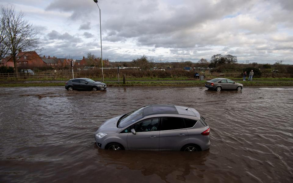 Cars have become stranded in floodwater on Derby Road in Hathern, Leicestershire - Joe Giddens/PA