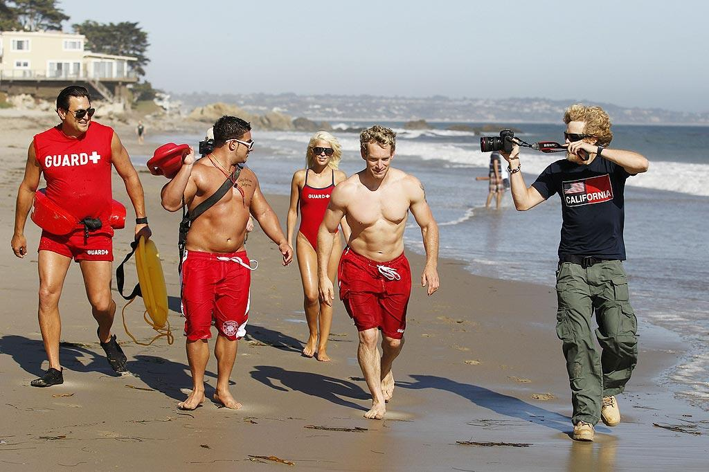 """The reality villain was busy filming scenes for what appeared to be a """"Baywatch"""" spoof starring ... Snooki's beefy ex-boyfriend Emilio Masella (second from the left). Nate Jones/James Breeden/<a href=""""http://www. PacificCoastNews.com"""" target=""""new"""">PacificCoastNews.com</a> - July 14, 2010"""