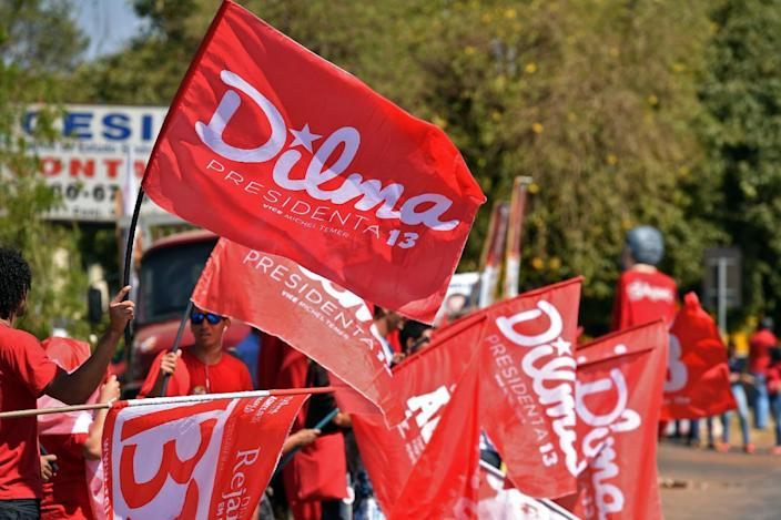 Brazilian Workers' Party supporters hold flag during a rally with their presidential candidate and current President Dilma Rousseff at the National Confederation of Rural Workers in Brasilia, Brazil on August 28, 2014 (AFP Photo/Evaristo SA)