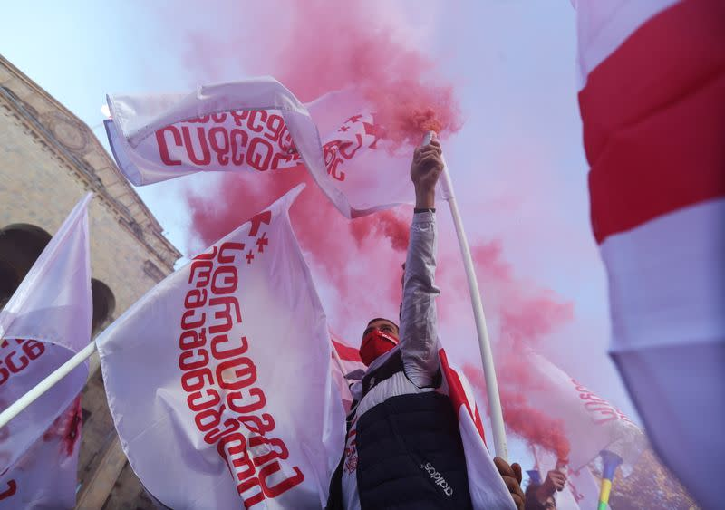 Opposition supporters protest against results of a parliamentary election