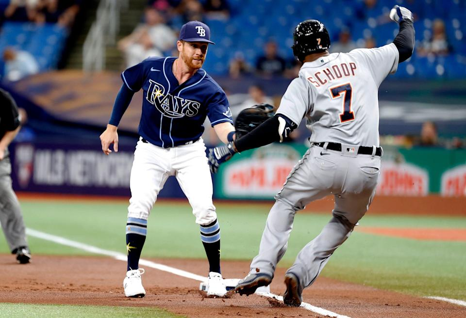 Tampa Bay Rays right fielder Jordan Luplow (25) tags out Detroit Tigers second baseman Jonathan Schoop (7) during the first inning at Tropicana Field in St. Petersburg, Florida, on Thursday, Sept. 16, 2021.