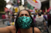 A woman attends a protest against Brazilian President Jair Bolsonaro's handling of the COVID-19 pandemic, the economy and corruption, on Independence Day in Rio de Janeiro, Brazil, Tuesday, Sept. 7, 2021. (AP Photo/Silvia Izquierdo)