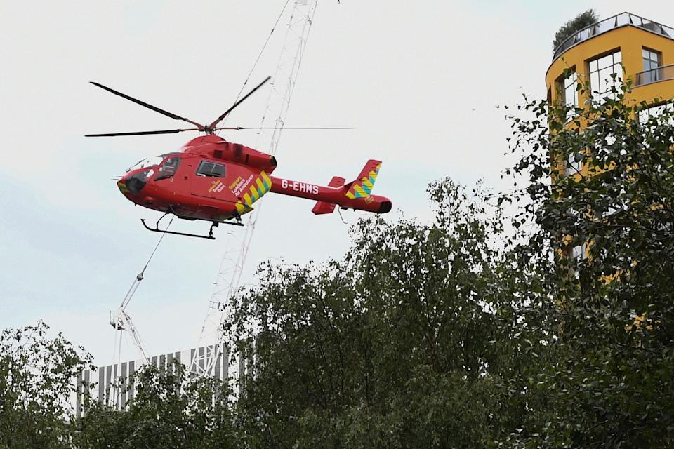 """A London Air Ambulance helicopter takes off from outside the Tate Modern gallery in London on August 4, 2019 after it was put on lock down and evacuated after an incident involving a child falling from height and being airlifted to hospital. - London's Tate Modern gallery was evacuated on Sunday after a child fell """"from a height"""" and was airlifted to hospital. A teenager was arrested over the incident, police said, without giving any details of the child's condition. (Photo by Daniel SORABJI / AFP)        (Photo credit should read DANIEL SORABJI/AFP/Getty Images)"""