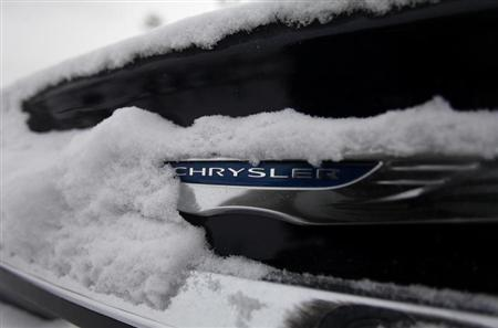 Snow surrounds the Chrysler logo displayed on a vehicle in the parking lot at Bill Snethkamp dealership in Detroit