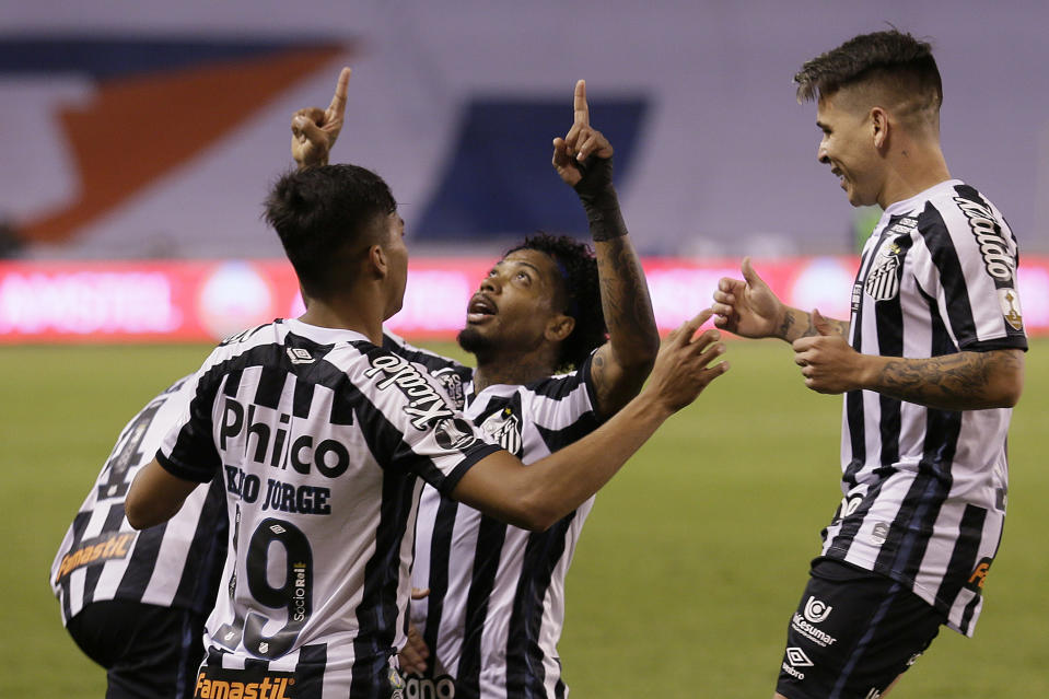 QUITO, ECUADOR - NOVEMBER 24: Marinho of Santos celebrates with teammates after scoring the second goal of their team during a round of sixteen first leg match between Liga Deportiva Universitaria and Santos at Rodrigo Paz Delgado Stadium on November 24, 2020 in Quito, Ecuador. (Photo by Dolores Ochoa - Pool/Getty Images)