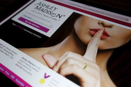 The homepage of the Ashley Madison website is displayed on an iPad, in this photo illustration taken in Ottawa, Canada July 21, 2015. REUTERS/Chris Wattie