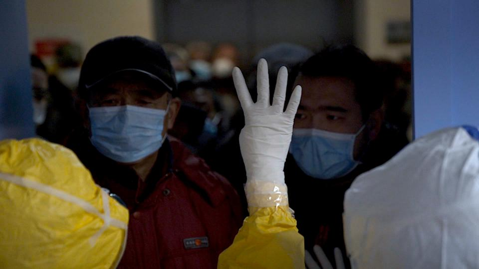 Medical workers limiting the number of patients admitted into a hospital during the peak of the COVID-19 outbreak in Wuhan, China. As seen in 76 Days, directed by Hao Wu, Weixi Chen and Anonymous. Image courtesy of 76 Days LLC.