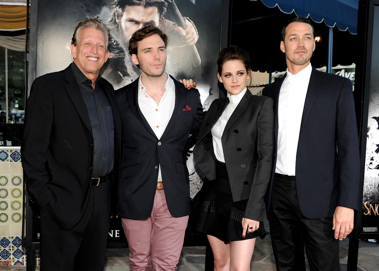 """LOS ANGELES, CA - MAY 29:  (L-R) Producer Joe Roth, actors Sam Claflin, Kristen Stewart and director Rupert Sanders arrive at a screening of Universal Pictures' """"Snow White and The Huntsman"""" at the Village Theatre on May 29, 2012 in Los Angeles, California.  (Photo by Kevin Winter/Getty Images)"""