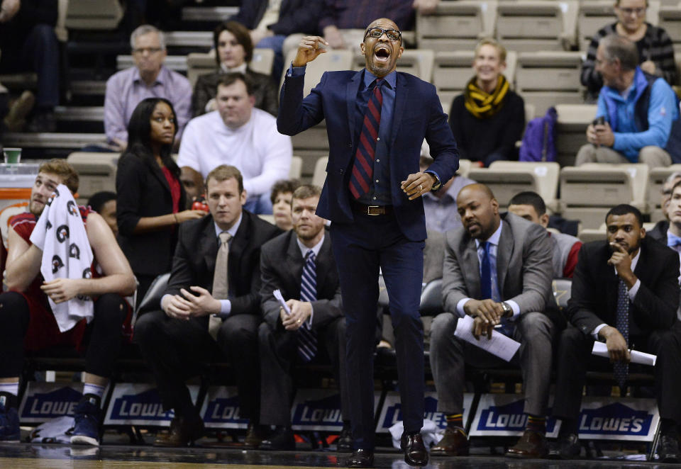 Penn coach Jerome Allen yells to his players during the first half of an NCAA college basketball game against Vanderbilt on Monday, Dec. 22, 2014, in Nashville, Tenn. (AP Photo/Mark Zaleski)