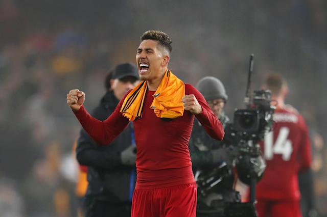 WOLVERHAMPTON, ENGLAND - JANUARY 23: Roberto Firmino of Liverpool celebrates victory after the Premier League match between Wolverhampton Wanderers and Liverpool FC at Molineux on January 23, 2020 in Wolverhampton, United Kingdom. (Photo by Catherine Ivill/Getty Images)