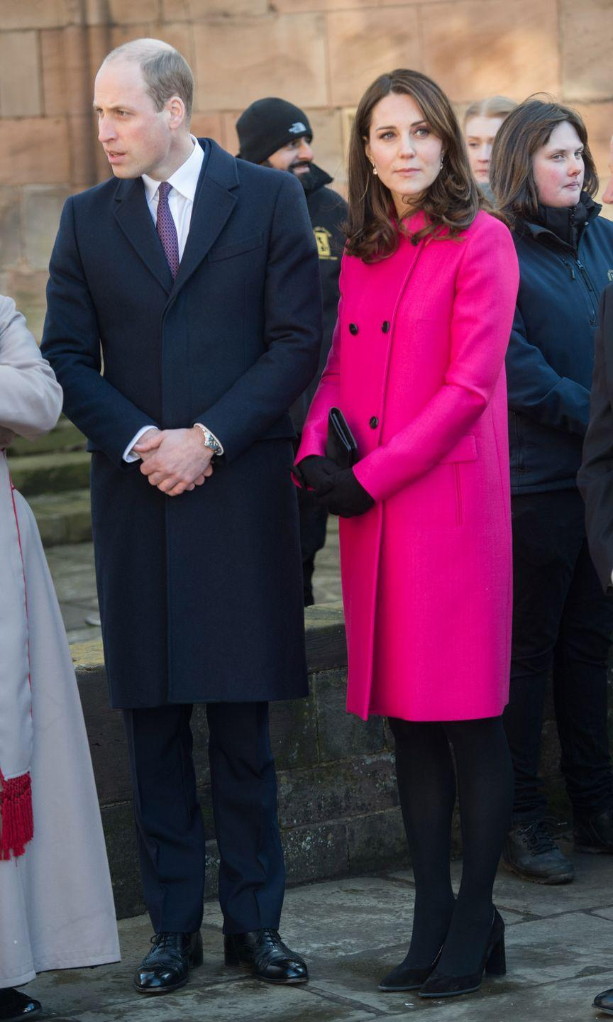 <p>In a hot pink double breasted coat by Mulberry, a black clutch, gloves, tights, and suede pumps during a visit to Coventry, England with Prince William. </p>
