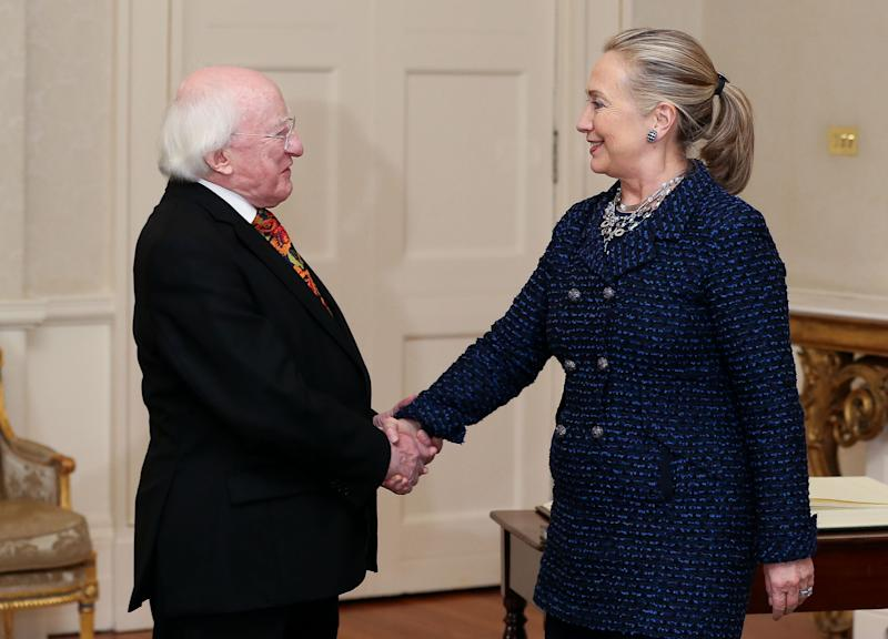 In this photo dated Thursday Dec. 6, 2012 issued by the Irish Government via Maxwells agency, President Michael D. Higgins shakes hands with US Secetary of State Hillary Rodham Clinton at Aras An Uachtarain, Dublin. (AP Photo/Maxwells, HO)