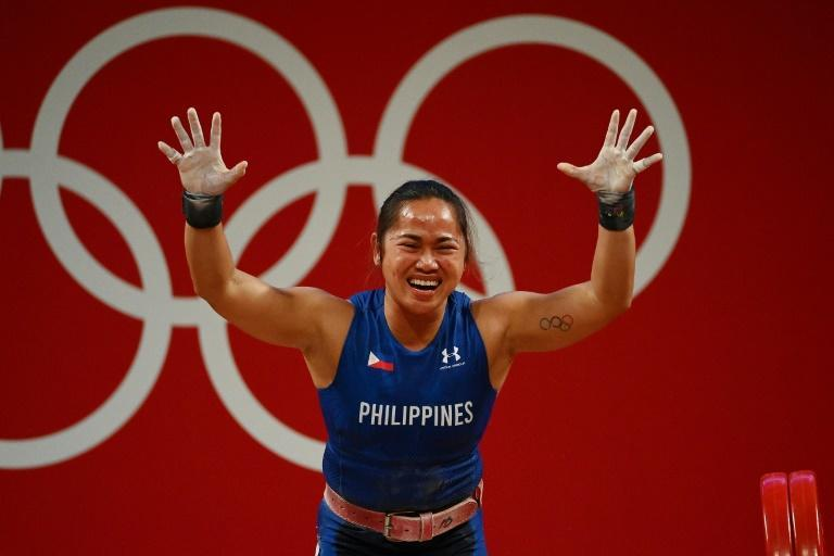 Philippines' Hidilyn Diaz reacts after placing first in the women's 55kg weightlifting competition during the Tokyo 2020 Olympic Games