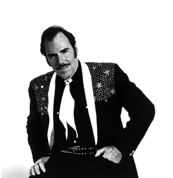 FILE - This 1980 file photo originally provided by Epic Records shows country singer Slim Whitman. Whitman died Wednesday, June 19, 2013 of heart failure in Florida. He was 90. Whitman's career began in the late 1940s, and his tenor falsetto and ebony mustache and sideburns became global trademarks. They were also an inspiration for countless jokes thanks to the ubiquitous 1980s and 1990s TV commercials that pitched his records. (AP Photo/Epic Records, file)