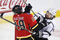 Los Angeles Kings' Drew Doughty, right, and Calgary Flames' Matthew Tkachuk scrap in front of the Kings' net during the first period of an NHL hockey game Saturday, Dec. 7, 2019, in Calgary, Alberta. (Larry MacDougal/The Canadian Press via AP)