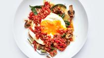 """For his take on this classic Mexican dish, which originated as a simple but hearty ranchers' breakfast, <strong>Rick Martinez</strong> adds a layer of cheesy sautéed poblanos and mushrooms to the tostada-egg-salsa trio. <a href=""""https://www.bonappetit.com/recipe/huevos-rancheros-con-rajas-y-champinones?mbid=synd_yahoo_rss"""" rel=""""nofollow noopener"""" target=""""_blank"""" data-ylk=""""slk:See recipe."""" class=""""link rapid-noclick-resp"""">See recipe.</a>"""