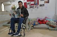 "Rached El Arbi, 30, was shot during the unrest in January 2011. Amnesty International says ""victims are still struggling to obtain justice and reparations for grave human rights violations committed during the revolution"""