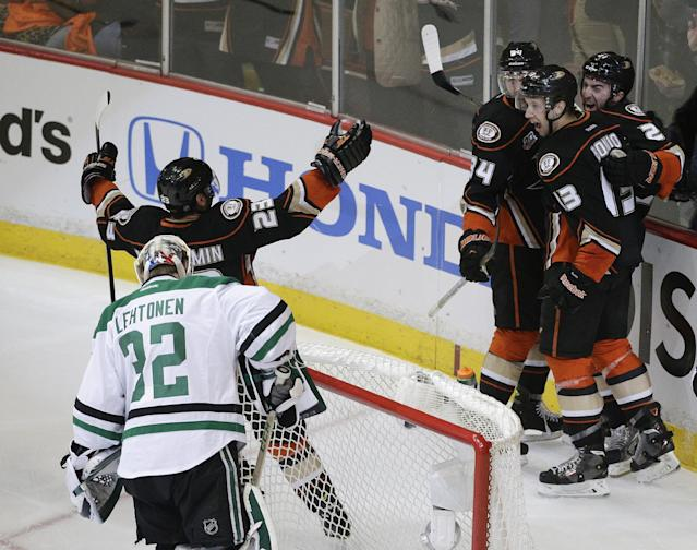 Anaheim Ducks' Kyle Palmieri (21) celebrates his goal with Nick Bonino (13), Francois Beauchemin (23) and Daniel Winnik (34) near Dallas Stars goalie Kari Lehtonen(32), of Finland, during the first period in Game 1 of the first-round NHL hockey Stanley Cup playoff series on Wednesday, April 16, 2014, in Anaheim, Calif. (AP Photo/Jae C. Hong)
