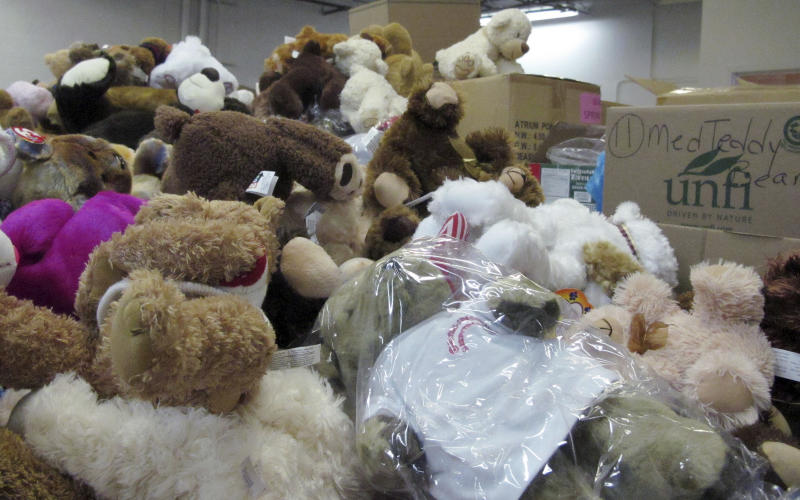 In this Monday, Dec. 31, 2012 photo, piles of donated stuffed animals await sorting in a warehouse in Newtown, Conn.  Tens of thousands of items have been sent to the town in the wake of the Dec. 14 massacre at the Sandy Hook Elementary School, forcing officials to set up an infrastructure to deal with the donations. (AP Photo/Pat Eaton-Robb)