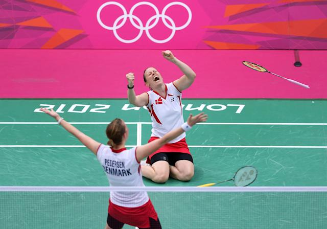 LONDON, ENGLAND - JULY 31: Christinna Pedersen and Kamilla Rytter Juhl of Denmark celebrate victory in their Women's Doubles Badminton match against Yunlei Zhao and Qing Tian of China on Day 4 of the London 2012 Olympic Games at Wembley Arena on July 31, 2012 in London, England.. (Photo by Julian Finney/Getty Images)