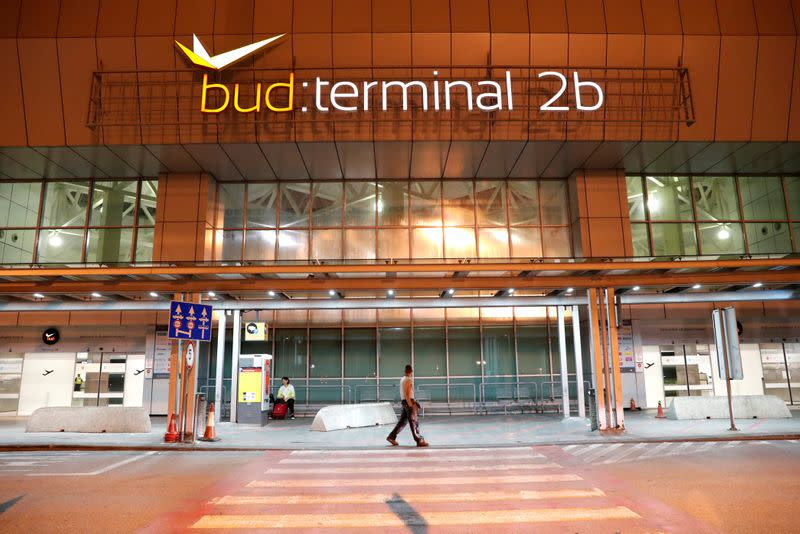 FILE PHOTO: A man walks in front of the Budapest Airport's terminal 2B