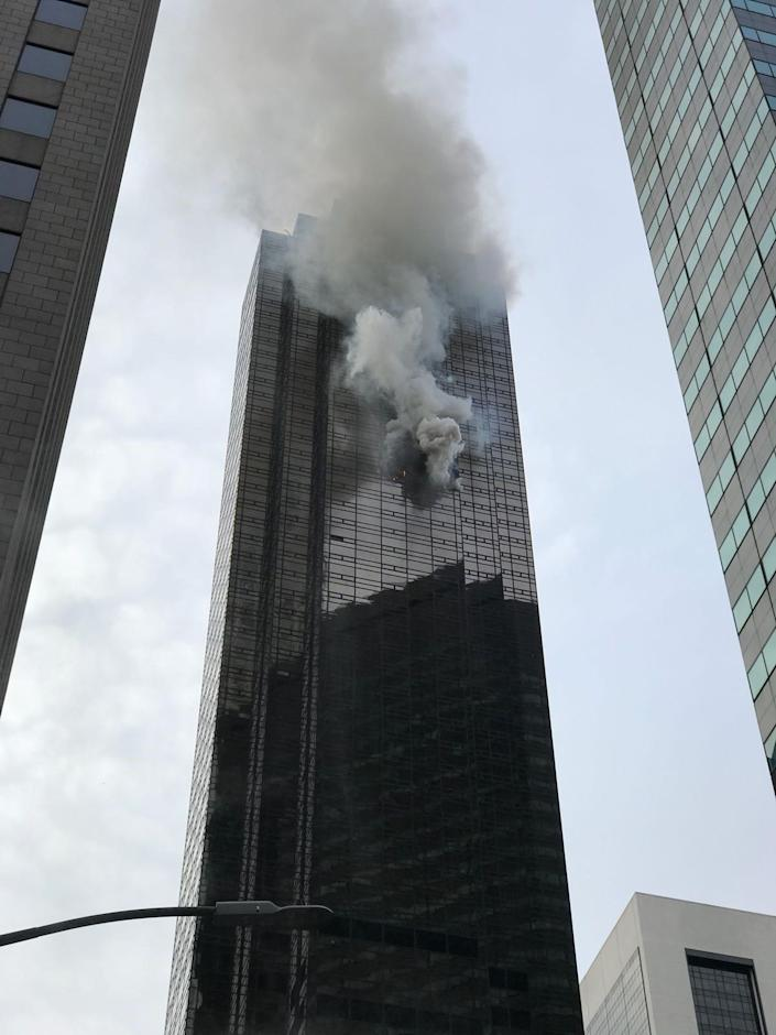 <p>Smoke rises from the 50th floor of Trump Tower in New York City on April 7, 2018. (Photo:Muhammed Said Tanl/Anadolu Agency/Getty Images) </p>