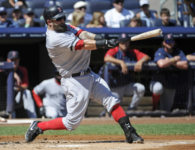 Boston Red Sox batter Mike Napoli hits a two-run home run during the second inning of a baseball game against the New York Yankees Saturday, Sept. 7, 2013, at Yankee Stadium in New York. (AP Photo/Bill Kostroun)