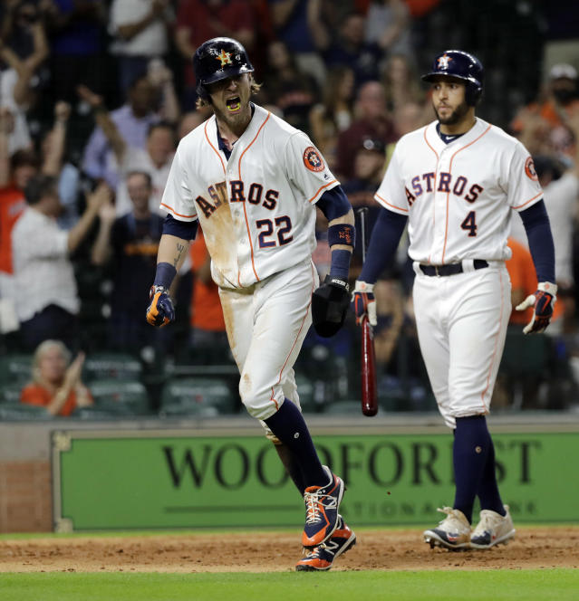 Houston Astros' Josh Reddick (22) reacts after scoring against the Oakland Athletics during the 11th inning of a baseball game Tuesday, July 10, 2018, in Houston. The Astros won 6-5. (AP Photo/David J. Phillip)
